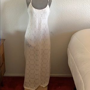 Lace maxi dress with slit on sides.